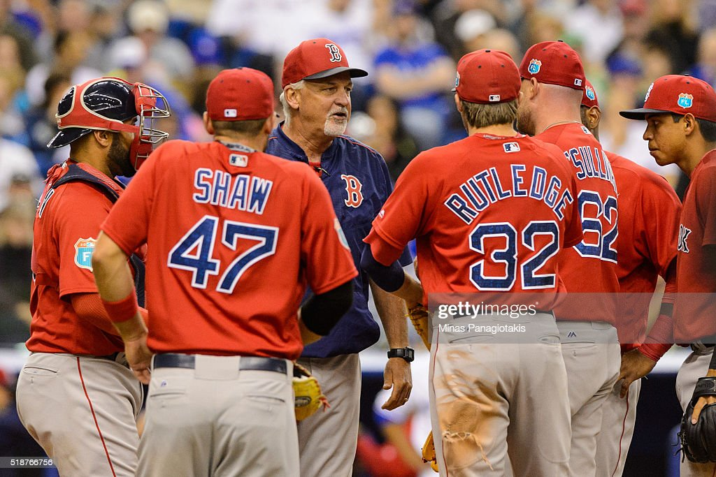Pitching coach of the Boston Red Sox Carl Willis regroups the team on the mound during the MLB spring training game against the Toronto Blue Jays at Olympic Stadium on April 2, 2016 in Montreal, Quebec, Canada. The Boston Red Sox defeated the Toronto Blue Jays 7-4.