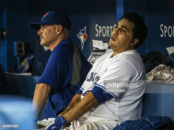 TORONTO ON AUGUST 22 Pitching coach Pete Walking and catcher Dioner Navarro of the Toronto Blue Jays show the pain on their faces as the Jays go down...