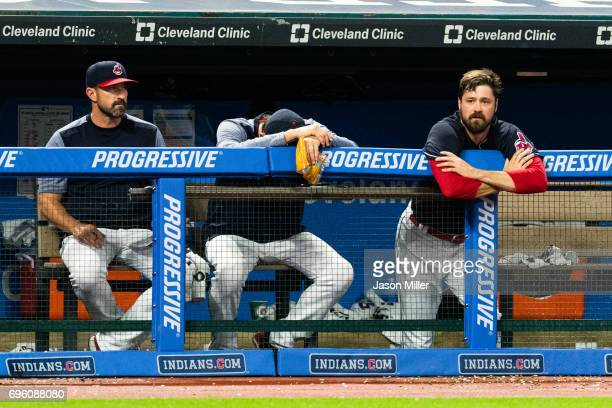 Pitching coach pitching coach Mickey Callaway sits with relief pitcher Andrew Miller of the Cleveland Indians watches from the dugout after giving up...