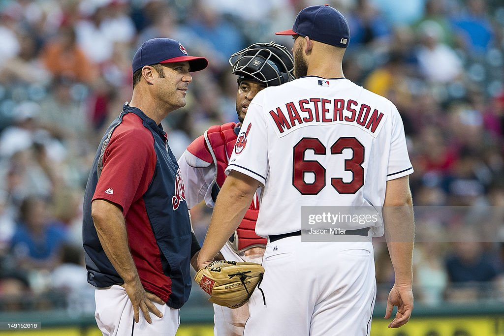 Pitching coach pitching coach Scott Radinsky #36 talks with catcher Carlos Santana #41 and starting pitcher Justin Masterson #63 of the Cleveland Indians during the fifth inning against the Baltimore Orioles at Progressive Field on July 23, 2012 in Cleveland, Ohio.