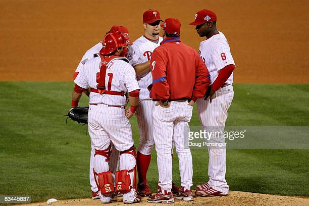 Pitching coach Rich Dubee talks with Joe Blanton of the Philadelphia Phillies during a game against the Tampa Bay Rays during game four of the 2008...