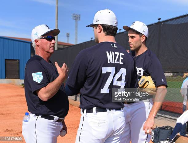 Pitching coach Rick Anderson of the Detroit Tigers talks with Matthew Boyd and Casey Mize during Spring Training workouts at the TigerTown Complex on...