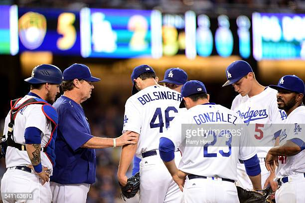 Pitching Coach Rick Honeycutt of the Los Angeles Dodgers visits Mike Bolsinger on the mound with the rest of the infield during the third inning...