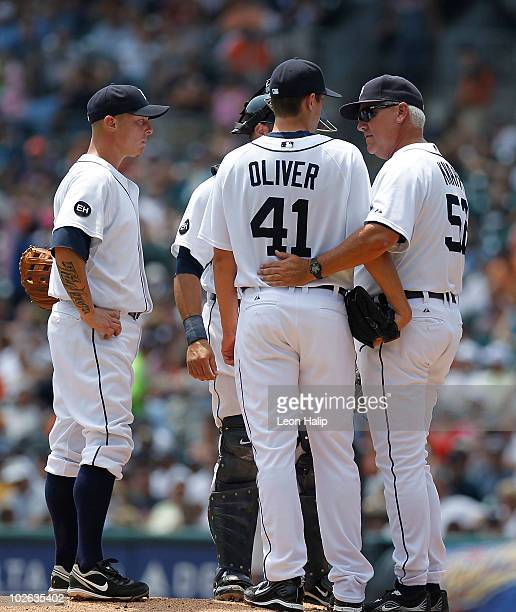 Pitching coach Rick Knapp of the Detroit Tigers talks with rookie pitcher Andy Oliver during the second inning of the game against the Baltimore...