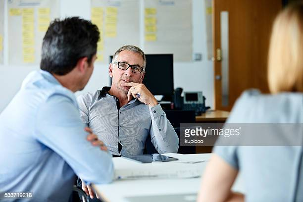 pitching their ideas to the boss - business finance and industry stock pictures, royalty-free photos & images