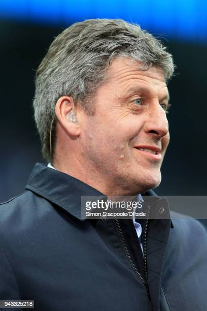 Pitchside pundit Andy Townsend looks on ahead of the Premier League match between Manchester City and Manchester United at the Etihad Stadium on...