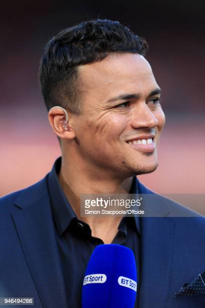Pitchside pundit Jermaine Jenas looks on during the Premier League match between Liverpool and AFC Bournemouth at Anfield on April 14 2018 in...