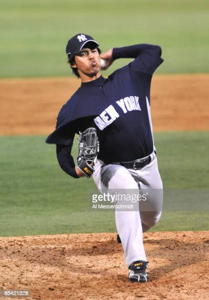 Pithcer Kei Igawa of the New York Yankees throws in relief against the Boston Red Sox March 13 2009 at City of Palms Park in Fort Myers Florida