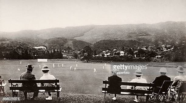 Pithhelmeted spectators watching a cricket match at the Cricket Ground at Shillong in Assam India circa 1900