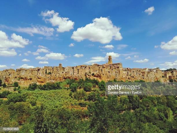 pitigliano town on hill against blue sky - grosseto province stock photos and pictures