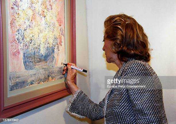 Pitita Ridruejo attends a painting and sculpture exhibition by Grupo A-12. One of the painting 'Silla en blanco y negro' was painted by her on...