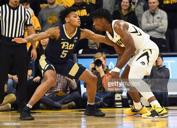 Pitt Panthers guard Au'Diese Toney guards Iowa Hawkeyes forward Tyler Cook in the first half during a nonconference college basketball game between...