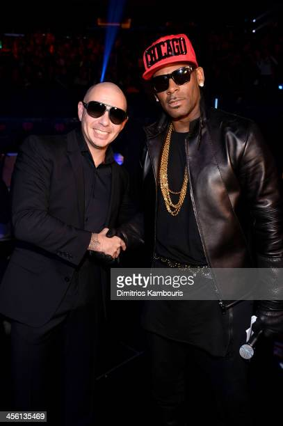 Pittbull and R Kelly pose backstage at Z100's Jingle Ball 2013 presented by Aeropostale at Madison Square Garden on December 13 2013 in New York City