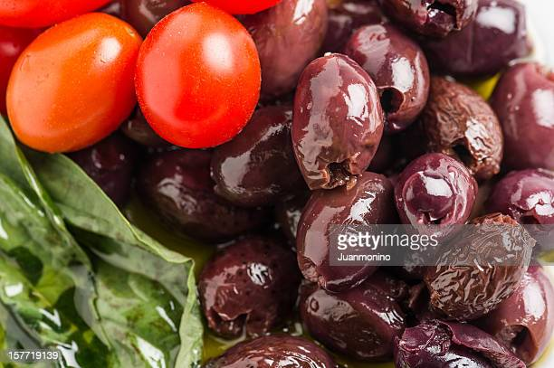 pitted calamata olives - kalamata olive stock photos and pictures