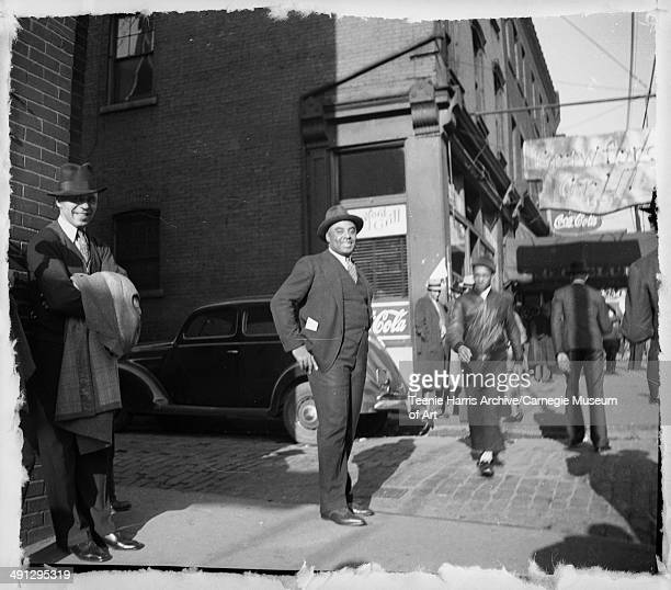 Pittsburgh Crawfords baseball player and manager Oscar Charleston, posing in street clothes outside Crawford Grill no 1, Wylie Avenue, Hill District,...