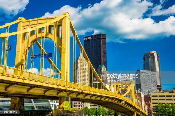pittsburgh downtown with yellow bridge, blue sky and clouds - pittsburgh stock pictures, royalty-free photos & images