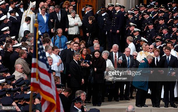 Pittsburgh firefighters salute as the caskets of Charles Brace and Richard Stefanakis are taken from St Paul's Cathedral Thursday following a funeral...