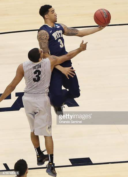 Pittsburgh guard Cameron Wright right scores the first points of the game in front of Colorado guard Xavier Talton during the NCAA Men's Basketball...