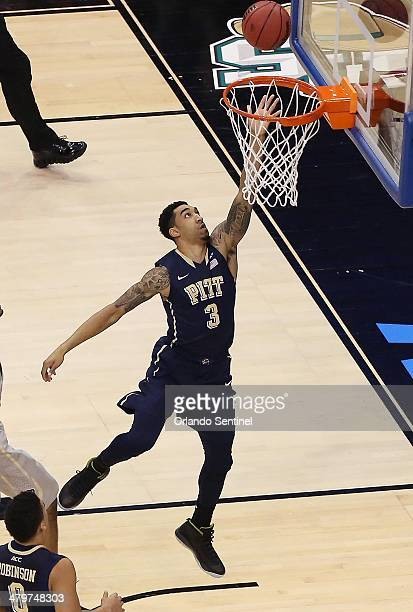 Pittsburgh guard Cameron Wright scores the first points of the game during the NCAA Men's Basketball Championship Second Round game against Colorado...