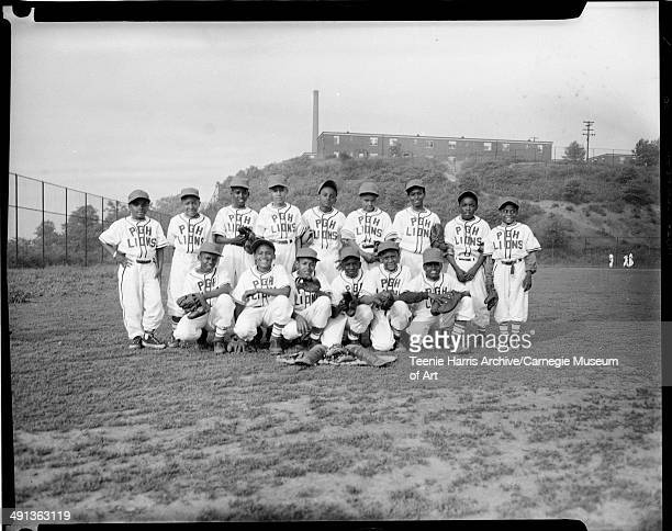 Pittsburgh Lions Little League baseball team on Kennard Field with Terrace Village in background Pittsburgh Pennsylvania May 1953 Kneeling from left...