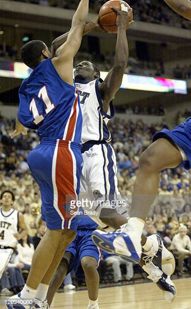Pittsburgh Panthers Carl Krauser drives on DePaul's Sammy Mejia during action at the Petersen Events Center on January 12, 2006 in Pittsburgh,...