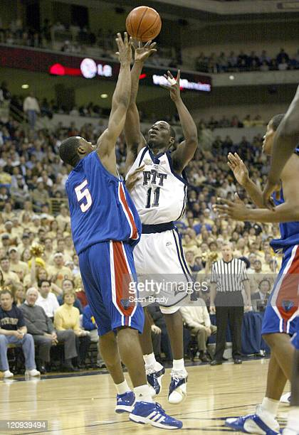 Pittsburgh Panthers Carl Krauser shoots over DePaul's Karron Clarke during action at the Petersen Events Center on January 12, 2006 in Pittsburgh,...