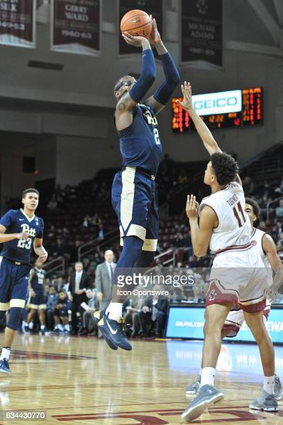 Pittsburgh Panthers forward Michael Young goes up for a three pointer During the Pittsburgh Panthers game against the Boston College Eagles on...