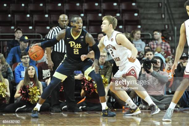Pittsburgh Panthers forward Michael Young tries to get past Boston College Eagles forward Connar Tava During the Pittsburgh Panthers game against the...