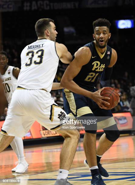 Pittsburgh Panthers forward Terrell Brown posts up on Notre Dame Fighting Irish forward John Mooney during the ACC men's tournament game between the...