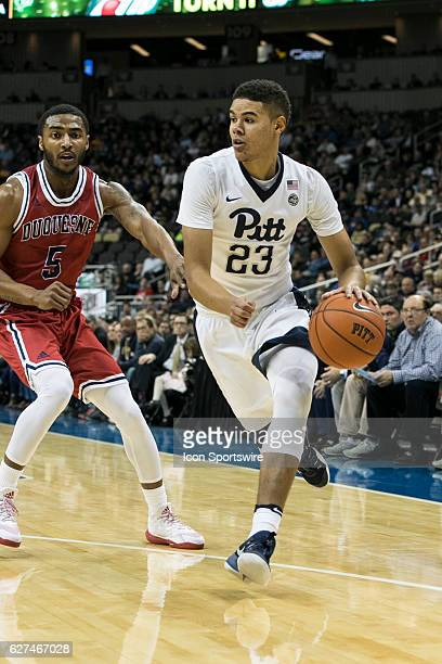 Pittsburgh Panthers Guard Cameron Johnson dribbles the ball up court during the NCAA Men's Basketball game between the Duquesne Dukes and the...