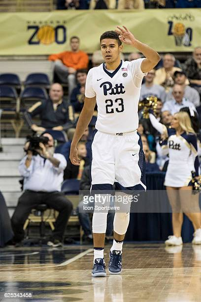 Pittsburgh Panthers Guard Cameron Johnson holds up three fingers after making his third three pointer in a row off the bench during the NCAA Men's...