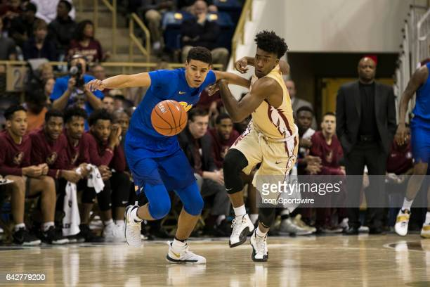 Pittsburgh Panthers Guard Cameron Johnson loses his dribble during the college basketball game between the Florida State Seminoles and the Pittsburgh...