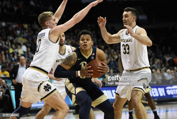 Pittsburgh Panthers guard Shamiel Stevenson is surrounded by Notre Dame Fighting Irish forward John Mooney and Notre Dame Fighting Irish guard Rex...