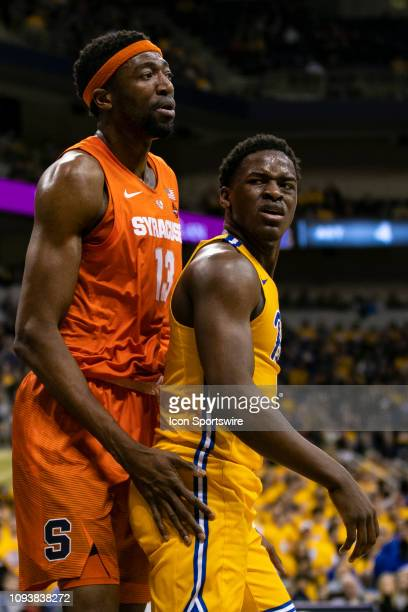 Pittsburgh Panthers guard Xavier Johnson reacts to Syracuse Orange center Paschal Chukwu fouling him during the college basketball game between the...
