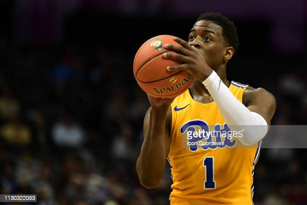 Pittsburgh Panthers guard Xavier Johnson shoots a technical foul shot during the ACC basketball tournament between the Boston College Eagles and the...