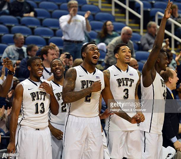 Pittsburgh Panthers players from left guard Josh Newkirk forward Lamar Patterson forward Michael Young guard Cameron Wright and forward Talib Zanna...