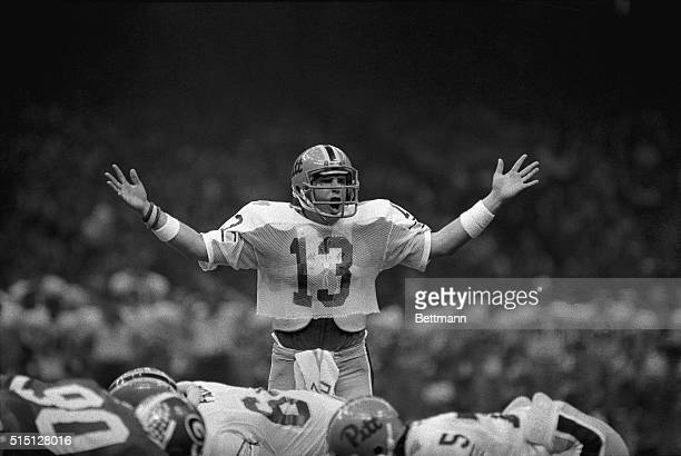 Pittsburgh Panthers quarterback Dan Marino, #13, uses his hands to try to tell the Sugar Bowl crowd to be quiet during a drive to score in the second...