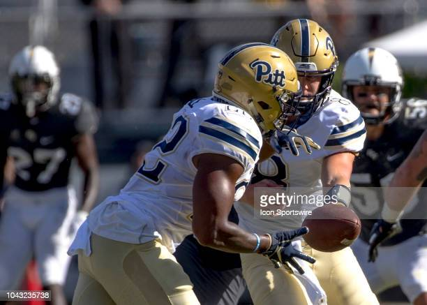 Pittsburgh Panthers quarterback Kenny Pickett hands off to running back Darrin Hall during the football game between the UCF Knights and Pitt on...