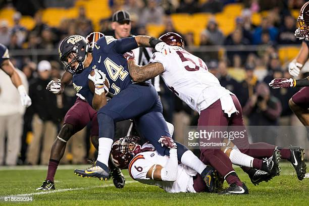 Pittsburgh Panthers Running back James Conner fights for extra yards as he runs over a defender during a NCAA Football game between the Virginia Tech...