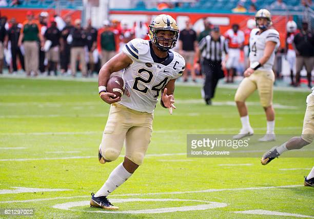 Pittsburgh Panthers Running Back James Conner runs with ball and scores a touchdown during the NCAA football game between the Pittsburgh Panthers and...