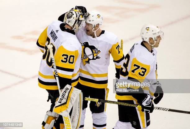 Pittsburgh Penguins center Evgeni Malkin and goaltender Matt Murray at the end of a NHL game between the Washington Capitals and the Pittsburgh...