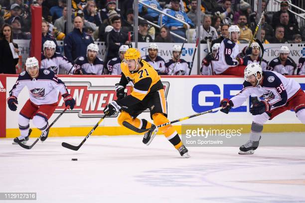 Pittsburgh Penguins Center Evgeni Malkin brings the puck up ice during the second period in the NHL game between the Pittsburgh Penguins and the...