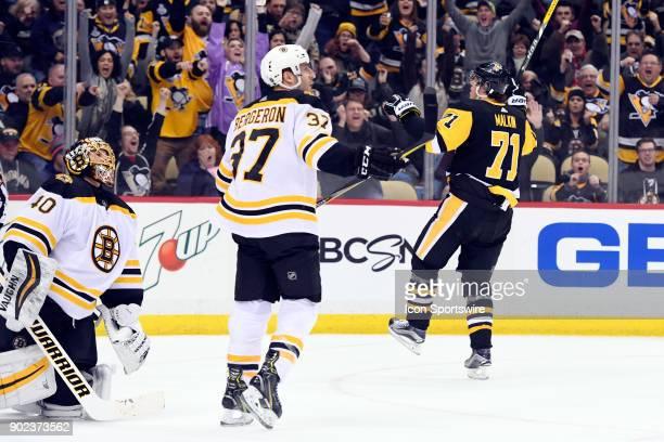 Pittsburgh Penguins Center Evgeni Malkin celebrates his game tying goal on Boston Bruins Goalie Tuukka Rask during the second period in the NHL game...