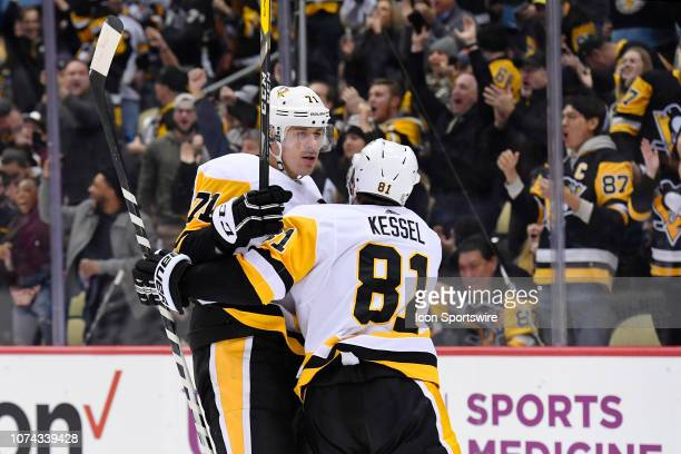 Pittsburgh Penguins Center Evgeni Malkin celebrates his goal with Pittsburgh Penguins Right Wing Phil Kessel during the first period in the NHL game...