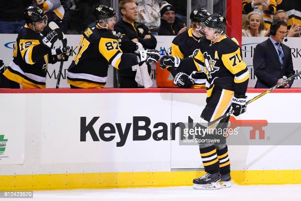 Pittsburgh Penguins Center Evgeni Malkin celebrates his second goal of the game with Pittsburgh Penguins Center Sidney Crosby on the bench during the...