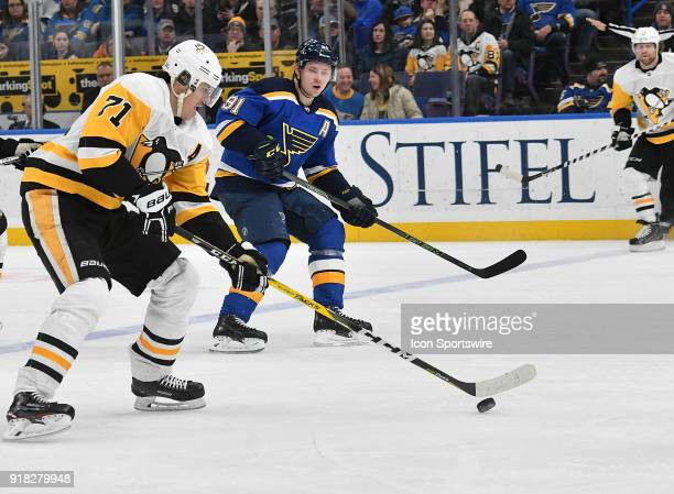 Pittsburgh Penguins center Evgeni Malkin controls the puck with pressure from St Louis Blues right wing Vladimir Tarasenko during a NHL game between...
