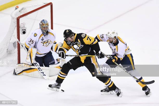 Pittsburgh Penguins center Evgeni Malkin deflects the puck off his skate in front of Nashville Predators goalie Pekka Rinne as during the second...