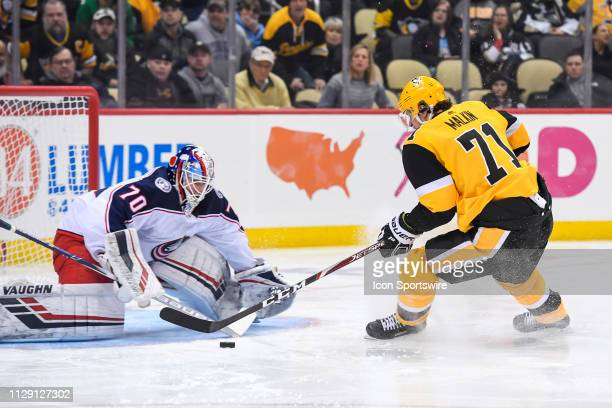 Pittsburgh Penguins Center Evgeni Malkin goes to the net with the puck on Columbus Blue Jackets Goalie Joonas Korpisalo during the second period in...
