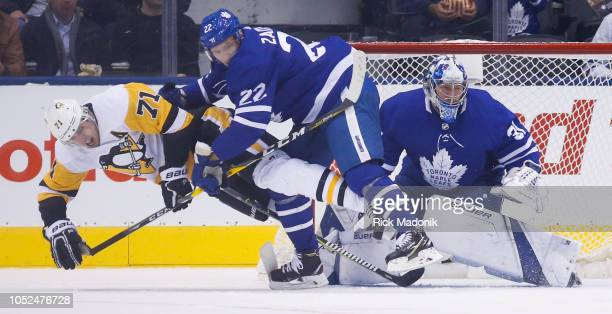 Pittsburgh Penguins center Evgeni Malkin is cleared from the slot by Toronto Maple Leafs defenseman Nikita Zaitsev in front of Toronto Maple Leafs...