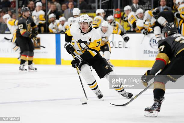 Pittsburgh Penguins Center Evgeni Malkin moves the puck up the ice during the game between the Vegas Golden Knights and the Pittsburgh Penguins on...